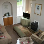 Gardeners Cottage offers a spacious lounge for guests to relax.