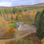 Aerial photograph of Ballintober, a magical cottage surrounded by Woodlands on Glenmuick Estate.