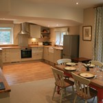 Ballintober self catering cottage dining room interior and kitchen facilities.