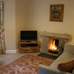 Ballintober self catering cottage offers a luxury living space for guests to enjoy with an open fireplace and homely furnishings.